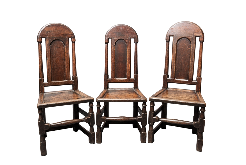 Three unusual William III Oak Derbyshire panelled back chairs