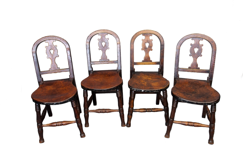 An unusual set of four Oak and Elm country chairs