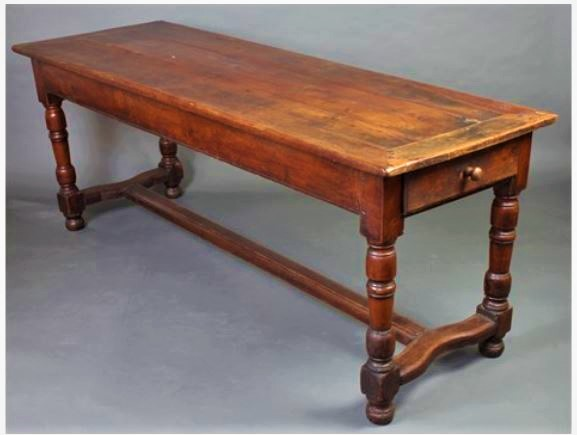 A continental Cherrywood table