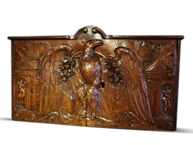 A late 17th.C. carved Walnut panel