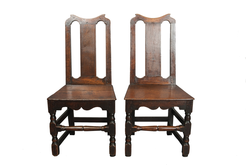 A pair of Oak high back chairs