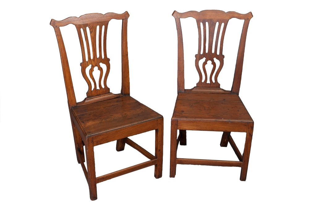 A pair of Oak and Elm country Chippendale chairs
