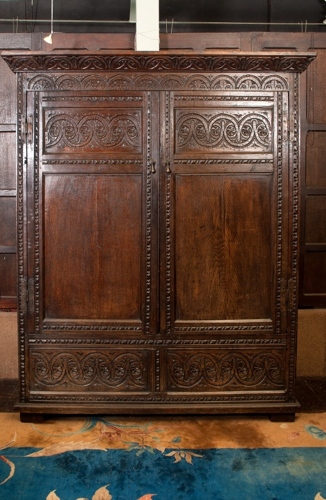 A William III Oak panelled Cupboard